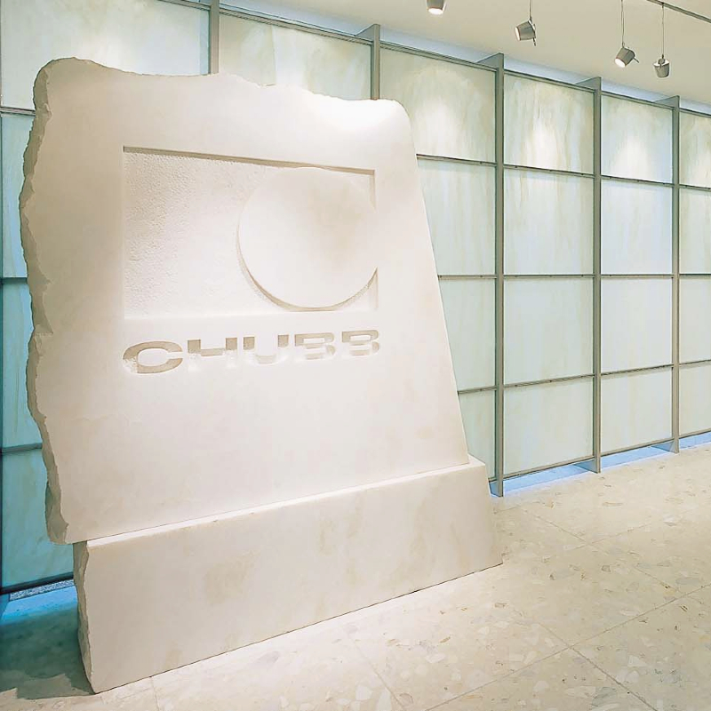 logo wall, white stone block, carved name