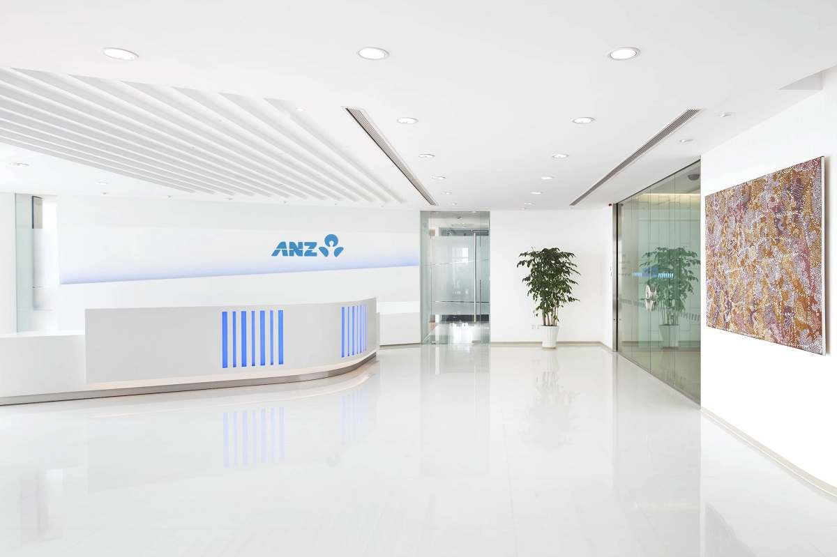 white reception area with artwork
